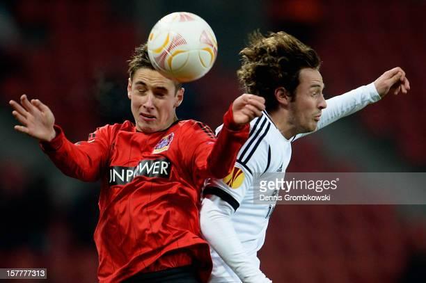 Dominik Kohr of Leverkusen and Mikkel Diskerud of Rosenborg Trondheim go up for a header during the UEFA Europa League Group K match between Bayer 04...