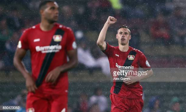 Dominik Kohr of Leverkusen celebrates his team's first goal during the DFB Cup first round match between Karlsruher SC and Bayer Leverkusen at...