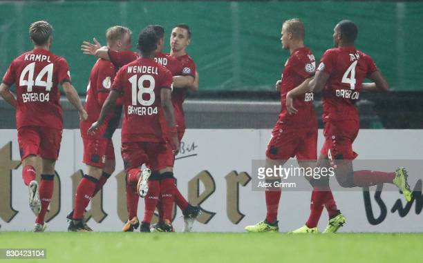 Dominik Kohr of Leverkusen celebrates his team's first goal with team mates during the DFB Cup first round match between Karlsruher SC and Bayer...