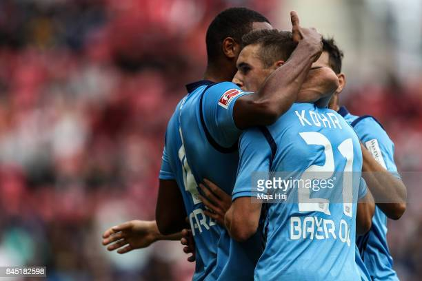 Dominik Kohr of Leverkusen celebrates with his teammates after scoring his team's first goal during the Bundesliga match between 1 FSV Mainz 05 and...