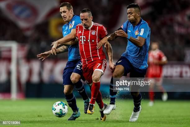Dominik Kohr of Leverkusen Franck Ribery of Bayern Muenchen and Benjamin Henrichs of Leverkusen battle for the ball during the Bundesliga match...