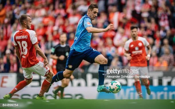 Dominik Kohr of Leverkusen in action against Daniel Brosinski of Mainz during the Bundesliga match between 1 FSV Mainz 05 and Bayer 04 Leverkusen at...