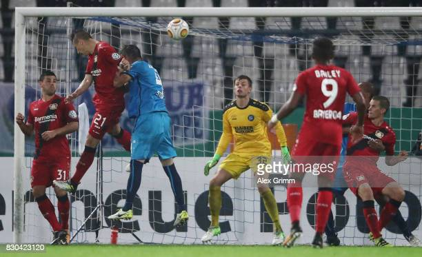 Dominik Kohr of Leverkusen scores his team's first goal during the DFB Cup first round match between Karlsruher SC and Bayer Leverkusen at...