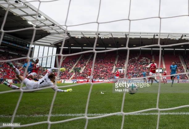 Dominik Kohr of Leverkusen scores his team's first goal past goalkeeper Rene Adler of Mainz during the Bundesliga match between 1 FSV Mainz 05 and...