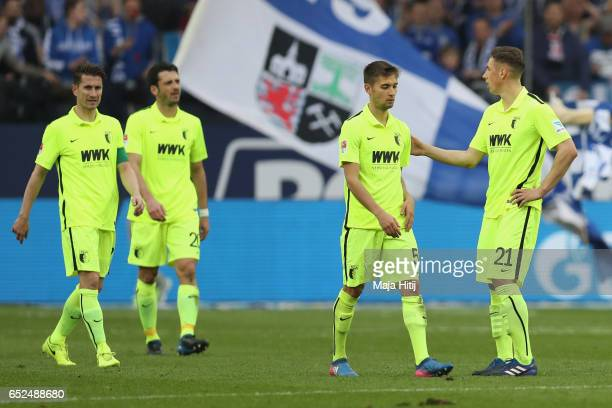Dominik Kohr of Schalke reacts with his team mate Moritz Leitner after the Bundesliga match between FC Schalke 04 and FC Augsburg at VeltinsArena on...