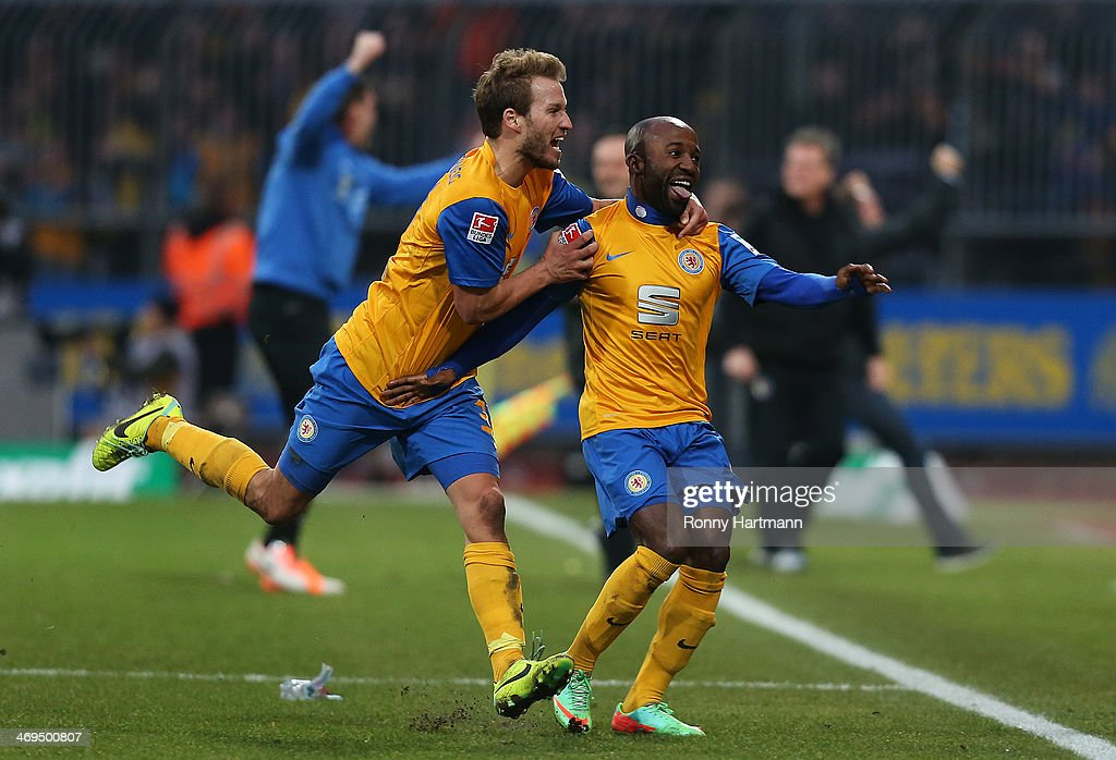 Dominik Kumbela (R) of Braunschweig celebrates his teams third goal with Marc Pfitzner of Braunschweig during the Bundesliga match between Eintracht Braunschweig and Hamburger SV at Eintracht Stadion on February 15, 2014 in Braunschweig, Germany.