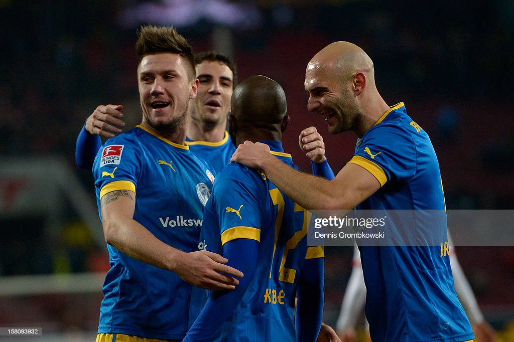 Dominik Kumbela of Braunschweig celebrates with teammates after scoring his team's first goal during the Bundesliga match between 1. FC Koeln and Eintracht Braunschweig at RheinEnergieStadion on December 10, 2012 in Cologne, Germany.