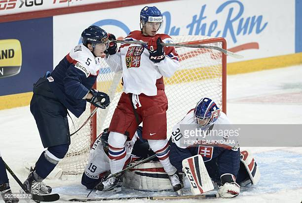 Dominik Lakatos of Czech Republic vies with Slovakia's Matej Moravcik and Slovakia's Adam Huska during the 2016 IIHF World Junior U20 Ice Hockey...