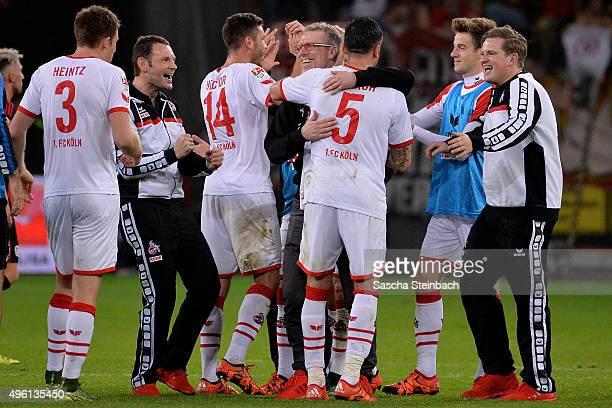 Dominik Maroh of Koeln is hugged by head coach Peter Stoeger after the Bundesliga match between Bayer Leverkusen and 1 FC Koeln at BayArena on...