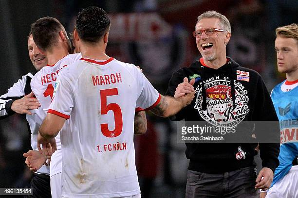 Dominik Maroh of Koeln is hugged by head coach Peter Stoeger after the Bundesliga match between Bayer Leverkusen and 1 FC Koeln at BayArena on...