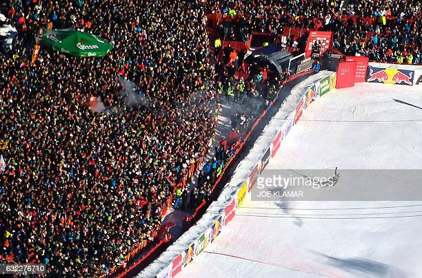 Dominik Paris of Italy celebrates his victory during the FIS World Cup men's downhill race at Hahnenkamm in Kitzbuehel Austria on January 21 2017...