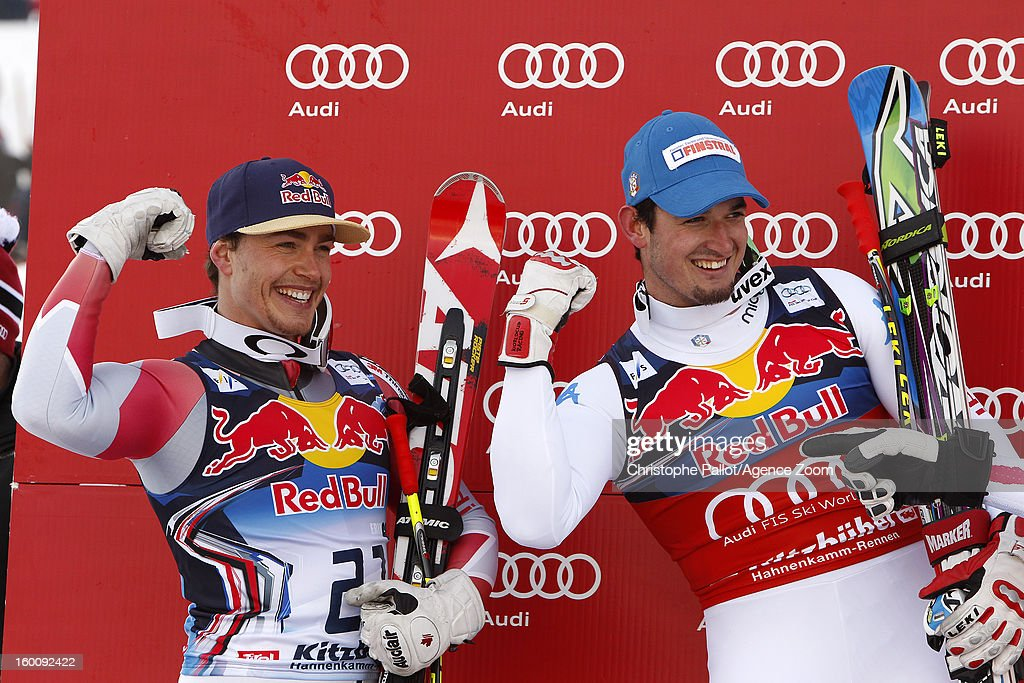 Dominik Paris of Italy takes 1st place, and Erik Guay of Canada takes 2nd place during the Audi FIS Alpine Ski World Cup Men's Downhill on January 26, 2013 in Kitzbuehel, Austria.