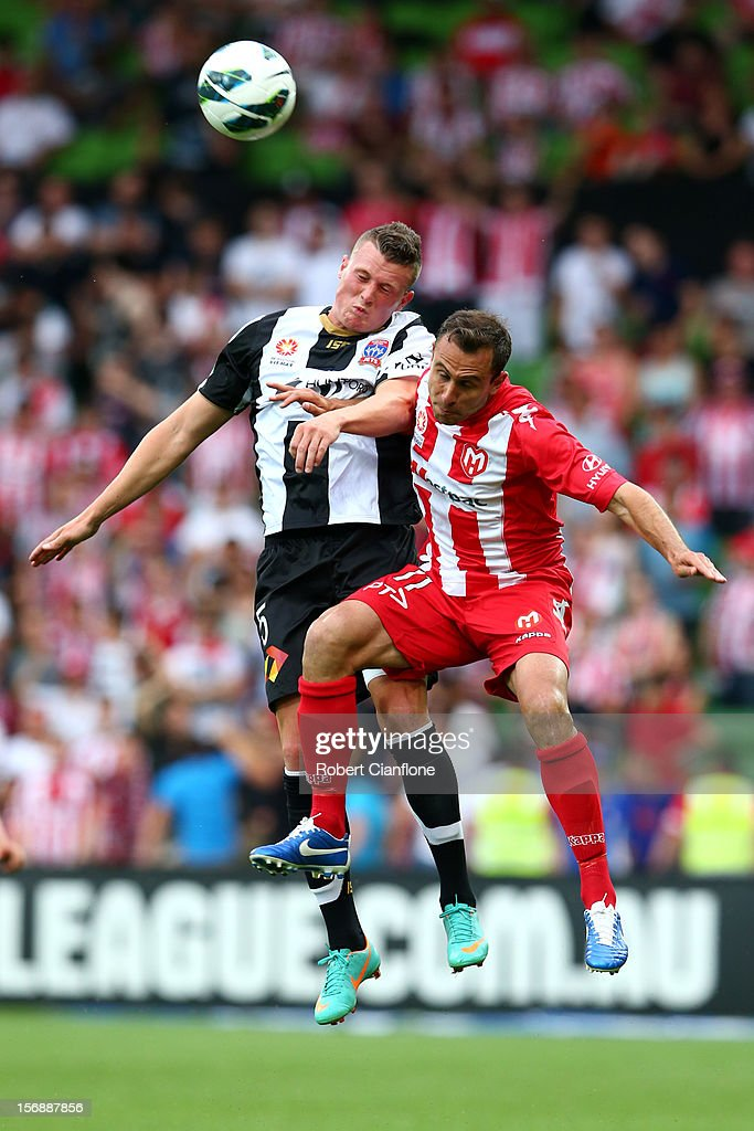Dominik Ritter of the Jets is challenged by Richard Garcia of the Heart during the round eight A-League match between the Melbourne Heart and the Newcastle Jets at AAMI Park on November 24, 2012 in Melbourne, Australia.