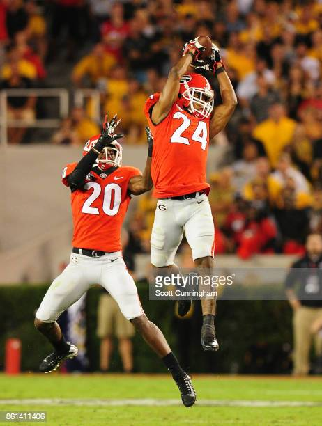 Dominik Sanders of the Georgia Bulldogs intercepts a 2nd quarter pass against the Missouri Tigers at Sanford Stadium on October 14 2017 in Athens...