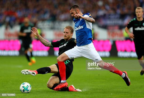 Dominik Schmidt of Kiel and Philipp Hofmann of Greuther Fuerth battle for the ball during the Second Bundesliga match between Holstein Kiel and SpVgg...