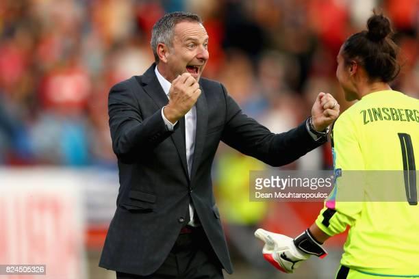 Dominik Thalhammer head coach of Austria and Manuela Zinsberger of Austria celebrate victory after the UEFA Women's Euro 2017 Quarter Final match...