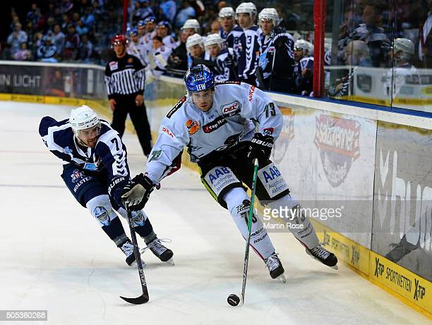 Dominik Tiffels of Hamburg Freezers battles for the puck with Michael Iggulden of Augsburger Panthers during the DEL game between Hamburg Freezers...