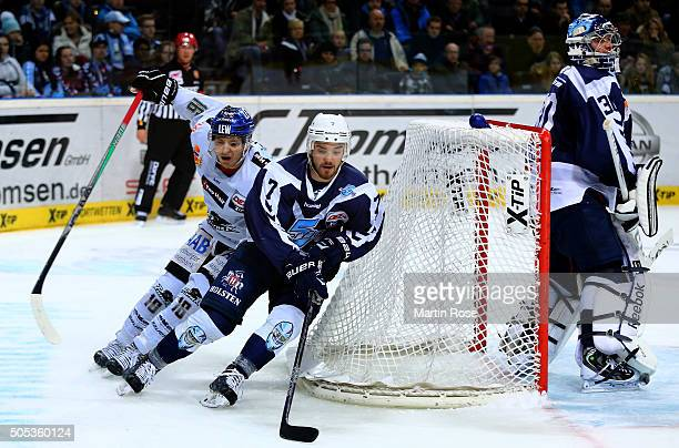 Dominik Tiffels of Hamburg Freezers battles for the puck with Aleksander Polaczek of Augsburger Panthers during the DEL game between Hamburg Freezers...