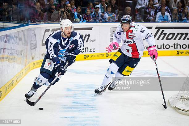 Dominik Tiffels of Hamburg of the Hamburg Freezers and Sven Ziegler of the Eisbaeren Berlin during the game between Hamburg Freezers and Eisbaeren...