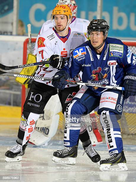 Dominik Tiffels of the Fischtown Pinguins and Greg Rallo of the Iserlohn Roosters during the test match between the Fischtown Pinguins and the...