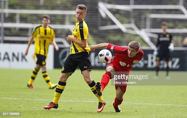 Dominik Wanner of Dortmund challenges Julijan Popovic of Leverkusen during the U17 German Championship Final match between Borussia Dortmund U17 and...