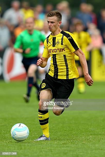 Dominik Wanner of Dortmund runs with the ball during the U17 German Championship Semi Final Second Leg match between Borussia Dortmund and VfB...
