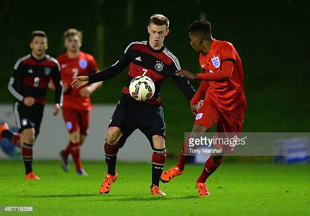 Dominik Wanner of Germany is tackled by Jaden Brown of England during the U17s International Friendly match between England U17 and Germany U17 at St...