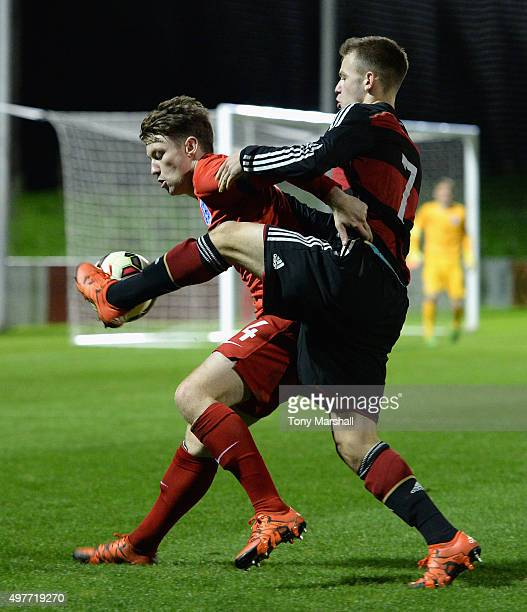 Dominik Wanner of Germany tackles Callum Slattery of England during the U17s International Friendly match between England U17 and Germany U17 at St...