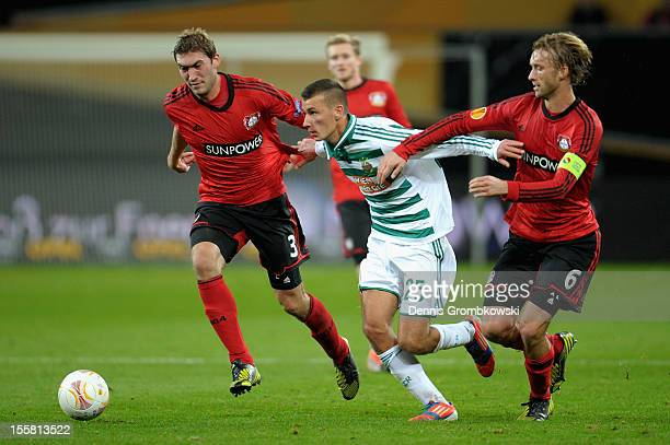Dominik Wydra of Wien is challenged by Stefan Reinartz and Simon Rolfes of Leverkusen during the UEFA Europa League Group K match between Bayer 04...