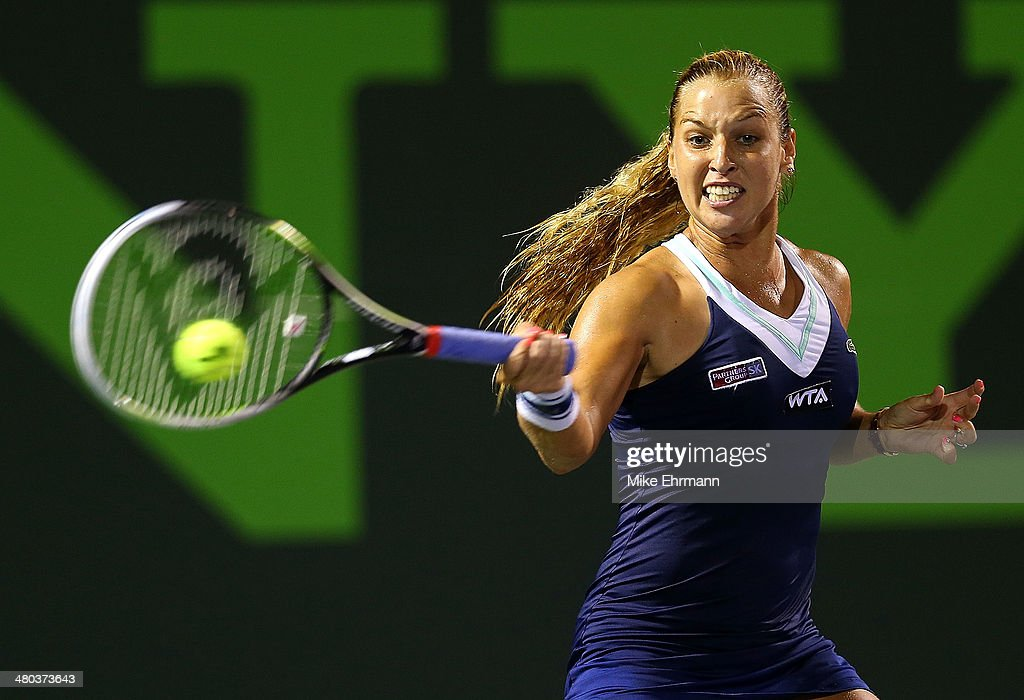 Dominika Ciblukova of Slovakia returns a shot to Venus Williams during their match on March 24, 2014 in Key Biscayne, Florida.