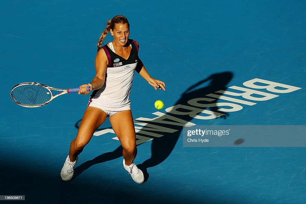 <a gi-track='captionPersonalityLinkClicked' href=/galleries/search?phrase=Dominika+Cibulkova&family=editorial&specificpeople=4091238 ng-click='$event.stopPropagation()'>Dominika Cibulkova</a> of Serbia plays a shot during her match against Daniela Hantuchova of Slovak during day one of the 2012 Brisbane International at Pat Rafter Arena on January 1, 2012 in Brisbane, Australia.