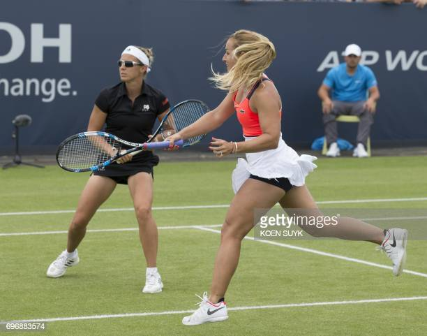 Dominika Cibulkova of Slovakia and Kirsten Flipkens of Belgium compete in the ladies double tennis final match at the Ricoh Open Tennis against Demi...