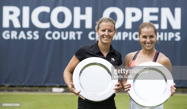 Dominika Cibulkova of Slovakia and Kirsten Flipkens of Belgium pose with their trophy after winning the ladies double tennis final match at the Ricoh...
