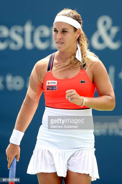 Dominika Cibulkova of Slovakia celebrates a point against Ana Konjuh of Croatia during day 4 of the Western Southern Open at the Lindner Family...