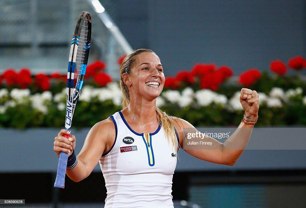 Dominika Cibulkova of Slovakia celebrates defeating Louisa Chirico of USA in the semi finals during day seven of the Mutua Madrid Open tennis...