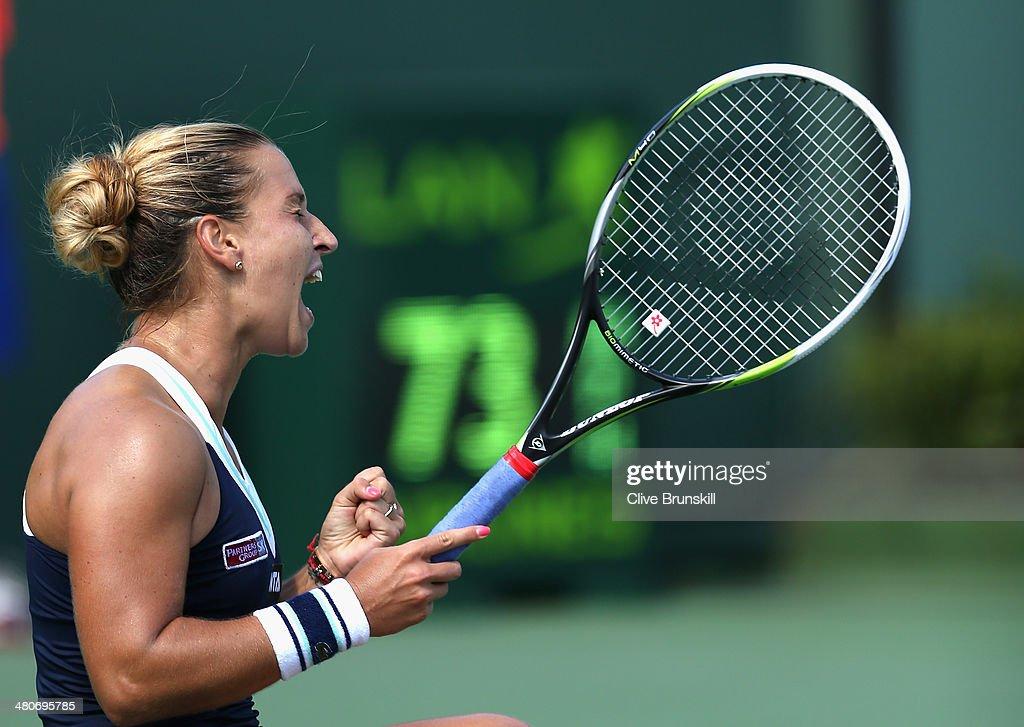 Dominika Cibulkova of Slovakia celebrates match point against Agnieszka Radwanska of Poland during their quarter final round match during day 10 at...