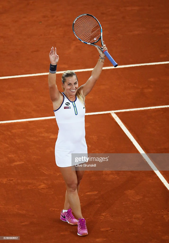 <a gi-track='captionPersonalityLinkClicked' href=/galleries/search?phrase=Dominika+Cibulkova&family=editorial&specificpeople=4091238 ng-click='$event.stopPropagation()'>Dominika Cibulkova</a> of Slovakia celebrates to the crowd after her straight sets victory against Louisa Chirico of the United States in their semi final match during day seven of the Mutua Madrid Open tennis tournament at the Caja Magica on May 06, 2016 in Madrid,Spain.