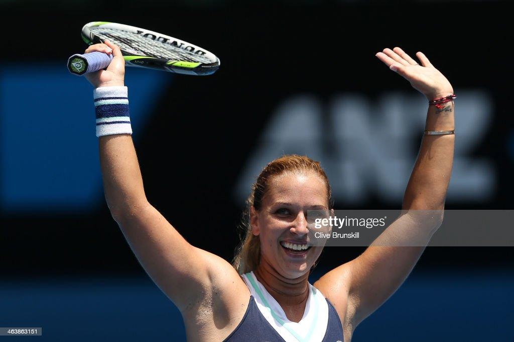 <a gi-track='captionPersonalityLinkClicked' href=/galleries/search?phrase=Dominika+Cibulkova&family=editorial&specificpeople=4091238 ng-click='$event.stopPropagation()'>Dominika Cibulkova</a> of Slovakia celebrates winning her fourth round match against Maria Sharapova of Russia during day eight of the 2014 Australian Open at Melbourne Park on January 20, 2014 in Melbourne, Australia.
