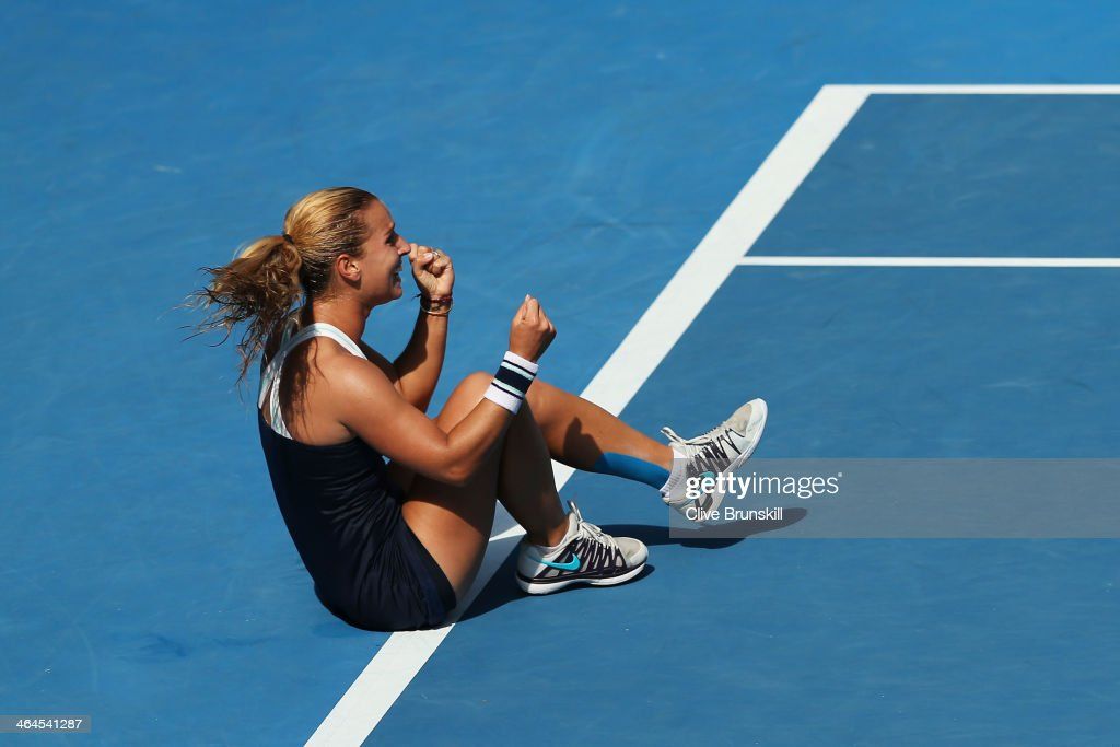 <a gi-track='captionPersonalityLinkClicked' href=/galleries/search?phrase=Dominika+Cibulkova&family=editorial&specificpeople=4091238 ng-click='$event.stopPropagation()'>Dominika Cibulkova</a> of Slovakia celebrates winning her semifinal match against Agnieszka Radwanska of Poland during day 11 of the 2014 Australian Open at Melbourne Park on January 23, 2014 in Melbourne, Australia.