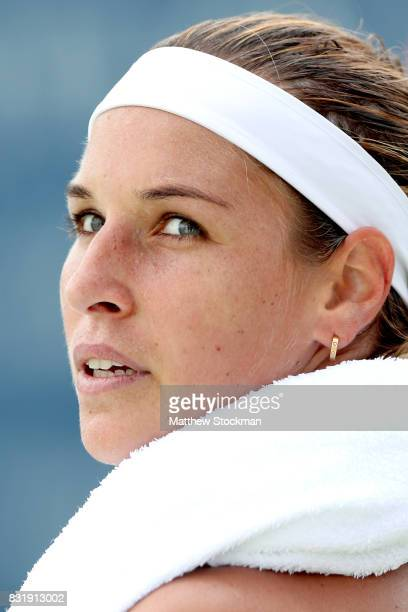 Dominika Cibulkova of Slovakia cools down between points while playing Ana Konjuh of Croatia during day 4 of the Western Southern Open at the Lindner...