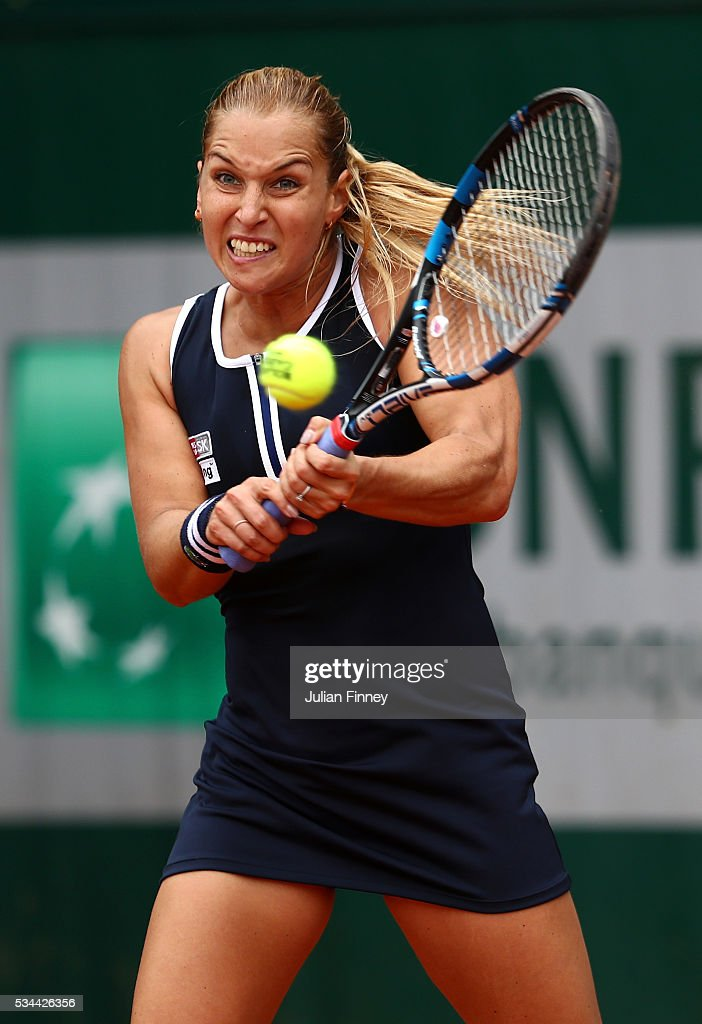 <a gi-track='captionPersonalityLinkClicked' href=/galleries/search?phrase=Dominika+Cibulkova&family=editorial&specificpeople=4091238 ng-click='$event.stopPropagation()'>Dominika Cibulkova</a> of Slovakia hits a backhand during the Ladies Singles second round match against Ana Konjuh of Croatia on day five of the 2016 French Open at Roland Garros on May 26, 2016 in Paris, France.