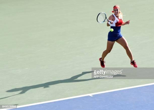 TOPSHOT Dominika Cibulkova of Slovakia hits a return against Carla Suarez Navarro of Spain during their women's singles first round match at the Pan...