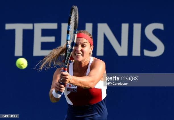 Dominika Cibulkova of Slovakia hits a return against Carla Suarez Navarro of Spain during their women's singles first round match at the Pan Pacific...