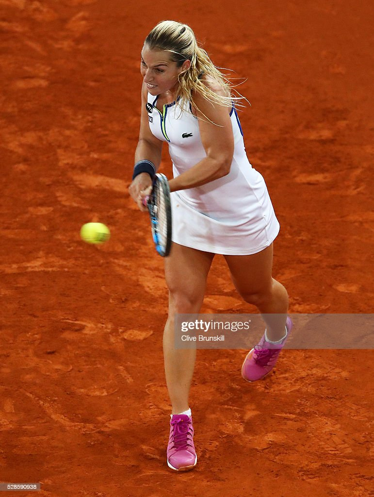 <a gi-track='captionPersonalityLinkClicked' href=/galleries/search?phrase=Dominika+Cibulkova&family=editorial&specificpeople=4091238 ng-click='$event.stopPropagation()'>Dominika Cibulkova</a> of Slovakia in action against Louisa Chirico of the United States in their semi final match during day seven of the Mutua Madrid Open tennis tournament at the Caja Magica on May 06, 2016 in Madrid,Spain.