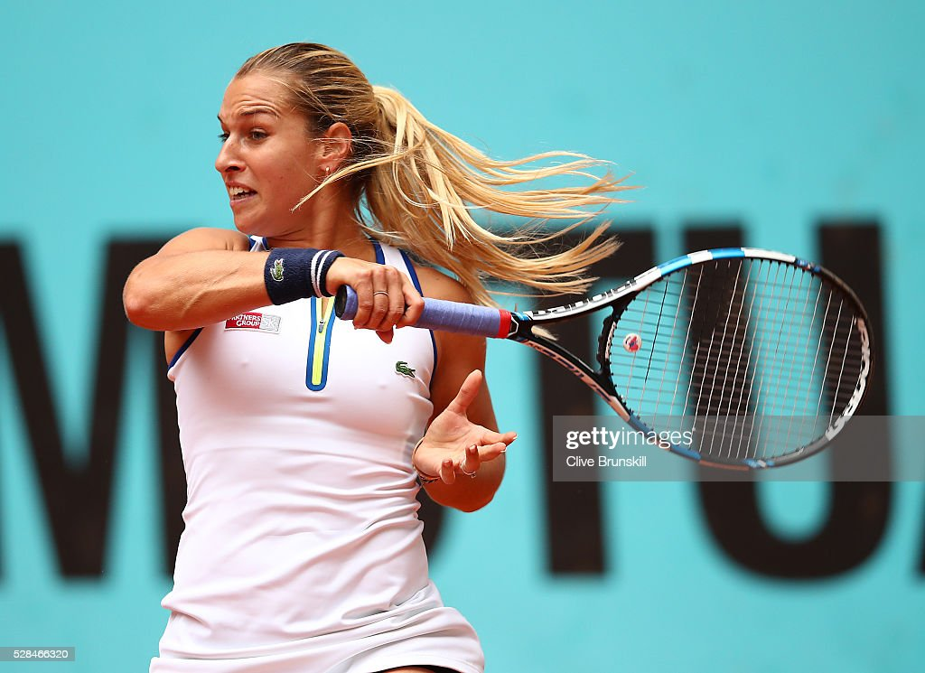Dominika Cibulkova of Slovakia in action against Sorana Cirstea of Romania in their quarter final match match during day six of the Mutua Madrid Open tennis tournament at the Caja Magica on May 05, 2016 in Madrid,Spain