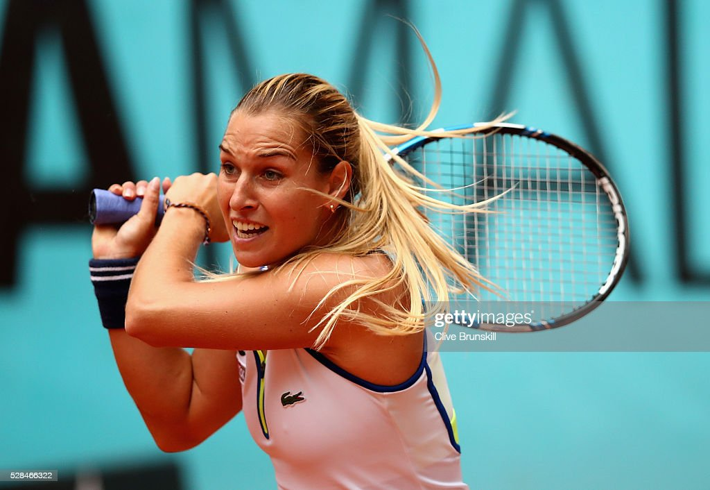 <a gi-track='captionPersonalityLinkClicked' href=/galleries/search?phrase=Dominika+Cibulkova&family=editorial&specificpeople=4091238 ng-click='$event.stopPropagation()'>Dominika Cibulkova</a> of Slovakia in action against Sorana Cirstea of Romania in their quarter final match match during day six of the Mutua Madrid Open tennis tournament at the Caja Magica on May 05, 2016 in Madrid,Spain