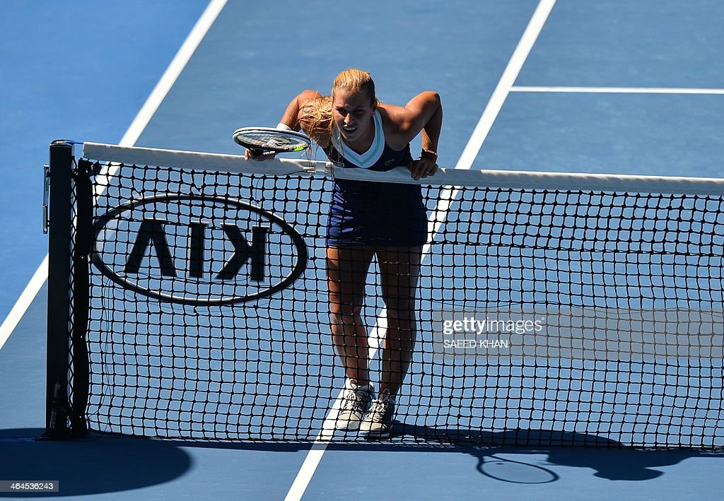 Dominika Cibulkova of Slovakia leans on the net while playing against Agnieszka Radwanska of Poland during their women's singles semi-final match on day 11 of the 2014 Australian Open tennis tournament in Melbourne on January 23, 2014.