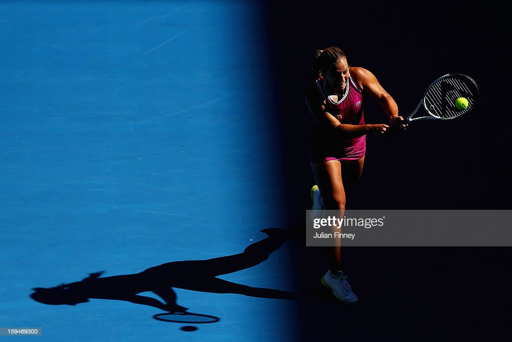 Dominika Cibulkova of Slovakia plays a backhand in her first round match against Ashleigh Barty of Australia during day one of the 2013 Australian Open at Melbourne Park on January 14, 2013 in Melbourne, Australia.