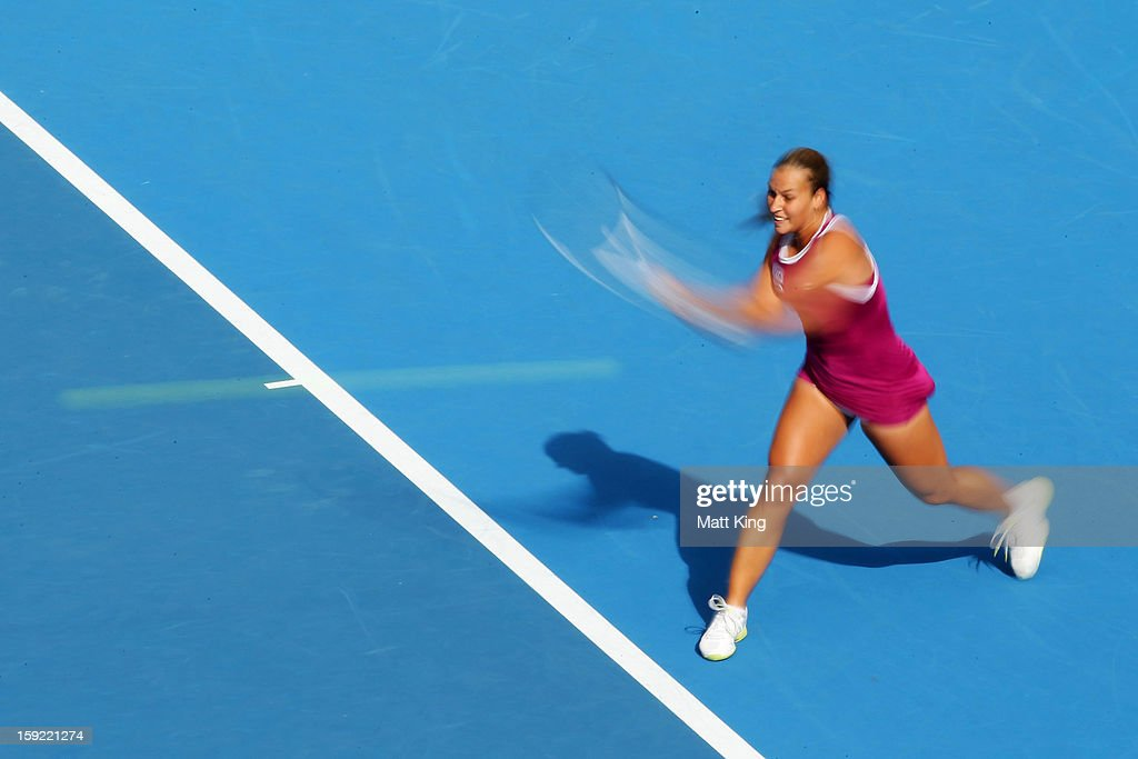 <a gi-track='captionPersonalityLinkClicked' href=/galleries/search?phrase=Dominika+Cibulkova&family=editorial&specificpeople=4091238 ng-click='$event.stopPropagation()'>Dominika Cibulkova</a> of Slovakia plays a backhand in her semi final match against Angelique Kerber of Germany during day five of the Sydney International at Sydney Olympic Park Tennis Centre on January 10, 2013 in Sydney, Australia.