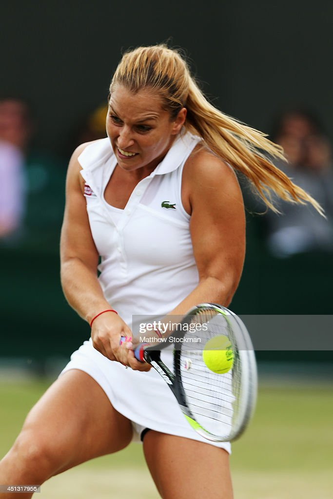 <a gi-track='captionPersonalityLinkClicked' href=/galleries/search?phrase=Dominika+Cibulkova&family=editorial&specificpeople=4091238 ng-click='$event.stopPropagation()'>Dominika Cibulkova</a> of Slovakia plays a backhand return during her Ladies' Singles third round match against Lucie Safarova of Czech Republic on day five of the Wimbledon Lawn Tennis Championships at the All England Lawn Tennis and Croquet Club on June 27, 2014 in London, England.